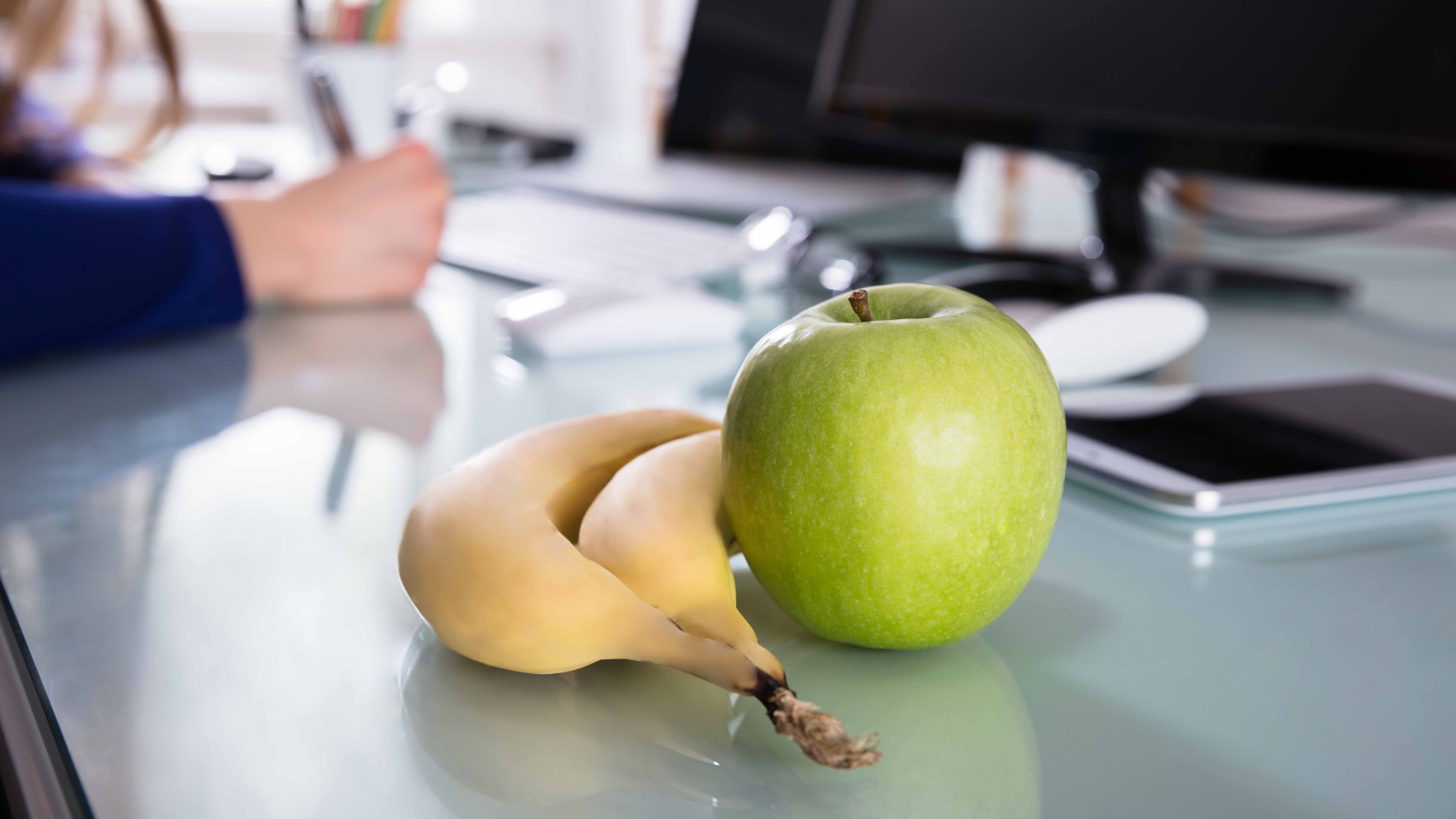 Banana and apple on a table